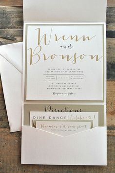 Bronson Wedding Invitation LARGE Pocketfold with Ribbon Tie - Ivory, Gold & Black (customizable). $8.99, via Etsy.