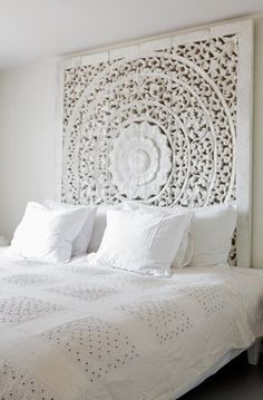 Stunning head board...saw heaps of carvings like this in Thailand - coat of paint and hang