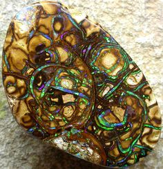 This stunning stone is from Yowah which is known for its amazing patterns . This stone hasaelectricgem GREEN precious opal embedded in the ironstone