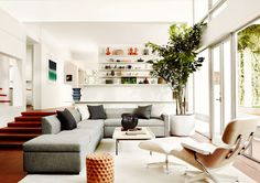 Neutral living room , lower levellounge with Eames lounge chair