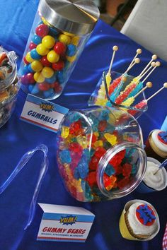 superhero party ideas-candy bar in superman colors & love shooting bad guys with string stuff