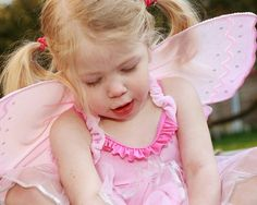Cute little girl in a pink fairy costume