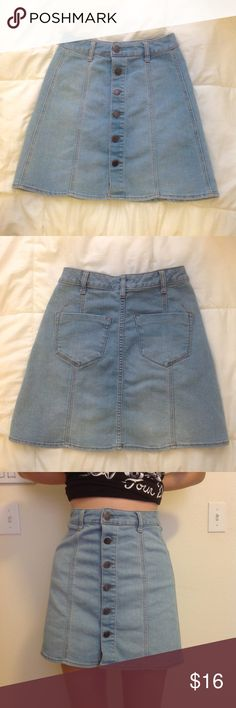 jean a line high waisted button up skirt NWOT adorable jean 90s style button up skirt, not brandy. tag says 00 but it's too big on me so I had my sister (size s) model it. would suggest probably size S/25 Brandy Melville Skirts A-Line or Full