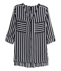 Black and white striped blouse in an airy woven fabric. V-neck, buttons at front, two chest pockets, and long sleeves with roll-up. | H&M Divided