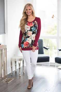With a stunning array of vibrant colors, this beautiful floral blouse is like a tropical vacation in your closet!