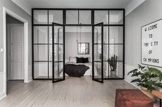 A Scandinavian home with grey walls & an industrial touch (Vosgesparis) Apartment Door, Apartment Design, Clean Apartment, Stockholm Apartment, Glass Wall Design, Glass Room Divider, Interior Architecture, Interior Design, Interior Doors