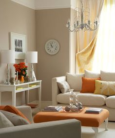 Add orange accessories to a room with a neutral colour palette for a pop of colour! Vary the shades and textures for added dimension. (via @Lisa Phillips-Barton Phillips-Barton Choe Simple www.realsimple.com)