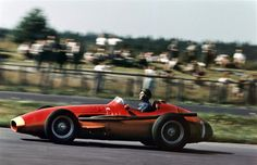 Nurburgring, 1957.  Fangio, in a Maserati 250F, wins the German Gran Prix securing his 5th and last world title.