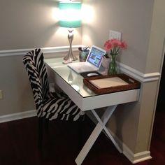 My office.  World Market Josephine Desk in White.  Zebra chair from Stein Mart.  Lamp from World Market.  Fresh flowers in a glass milk vase..always.