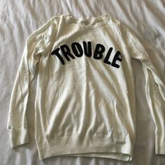 Soft cream 'trouble' sweater Fun, adorable and SUPER soft, really good quality for forever 21! Forever 21 Sweaters Crew & Scoop Necks