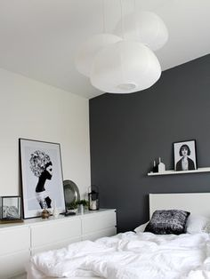 Black And White Bedroom, With Multiple Round Lamps And Framed Photo Art In  Different Sizes
