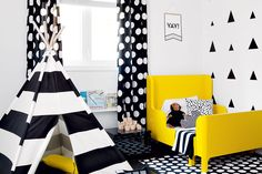 An energetic and untraditional little boy's room—Peppy polka dots, big stripes and bursts of sunshiny yellow create a kid-friendly space with room to grow.