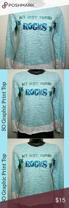 "SO My Best Friend Rocks Embellished Shirt SO ""My Best Friend Rocks"" long sleeve embellished blouse/shirt. Blue and White waves pattern. 100% cotton. Slogan in graphic screen reflective print and sequin embellishment. Layered look. Size 14 years/Large. Approximate measurements of the top are Shoulder 14 inches, Bust 32 inches, Length 22 inches, and Sleeve Length 22 inches. The fabric is stretchy. Very good condition. This SO top is gorgeous in person. SO Shirts & Tops"