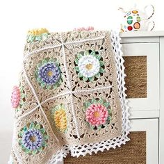 This garden-inspired crochet baby blanket is so precious just like the baby you'll be tucking in with it.