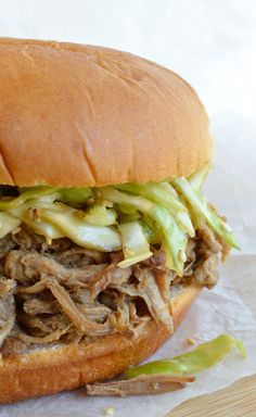 Chinese Five Spice Slow Cooker Pulled Pork Recipe - These Asian Spiced Pulled Pork Sandwiches are topped with marinated cabbage slaw, sesame seeds and served on a soft bun. These are made with pork tenderloin and great for a weeknight crockpot dinner!