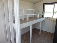 Roosting Rails and Poop Deck with SAND for easy cleaning.