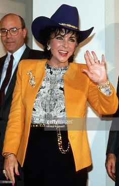Elizabeth Taylor wears a stetson hat in 1992 to promote her perfume at Neiman Marcus in Dallas, Texas.