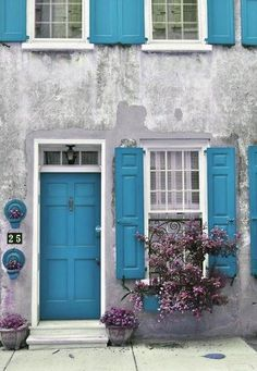 Old structure with blue shutters and door.