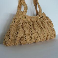Knitted purse in mustard yellow - hand knitted handbag - fall fashion handbag. $90.00, via Etsy.