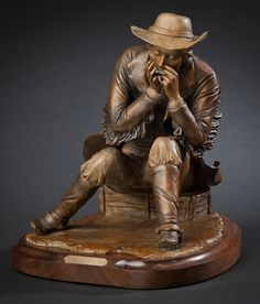 """Playing a Tune"" - Limited edition bronze sculpture of a cowboy playing the harmonica. #cowboyart"