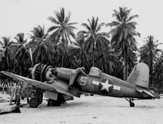 F4U-1A Corsair fighter of US Navy squadron VF-17 being serviced on Nissan Island, Green Islands, Mar 1944