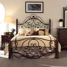 Sleep like royalty on this dramatic queen-size metal bed by Madero. This art deco-style bed features delicate bronze scrolls anchored by cherry posts, making it the perfect complement to a traditional decor scheme or an edgy addition to a modern room.