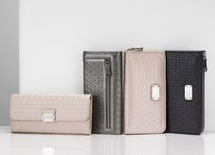 A collection of Tod's #Signature wallets in feminine and refined colors, with flap or zipper closure.