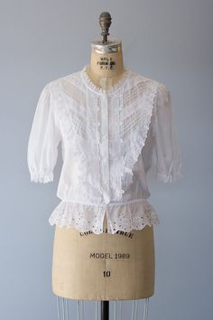 Vintage 1970s white cotton button down blouse with various lace trims, short puff should sleeves and elastic waist.  ✂ ✂ ✂ M E A S U R E M E N T S ✂ ✂