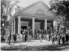 """Farm men and women gathered in front of Langdon Hall in August 1929.  The Auburn Alumnus said a record number attended Farmers' Week events """"to get practical information about their farm and home problems, and. . .get inspiration concerning a bigger and better rural life.""""  Nearly everyone wore a hat.  Attendance was promoted in the Digest, monthly publication of the Extension Service."""