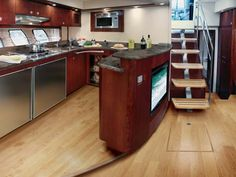 The galley of the 610 Sundancer with standard raised hardwood floor is one of the largest we have seen in this size express. Note the TV screen which faces the settee on the port side of the salon