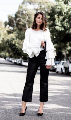 Black trouser, black stilettos and white original shirt. Mid length hair. Fashion Trends.
