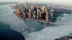 CBS Evening News has captured a stunning aerial photo of Manhattan Island surrounded by the frozen waters of New York Harbor due to the record low temperatures that have recently plagued New York C...