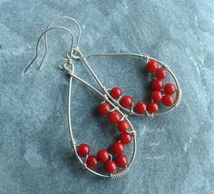 Sterling silver earrings with bamboo coral beads by Harsh and Sweet. Small bamboo coral beads are embellishing the teardrop silver frame of these earrings.