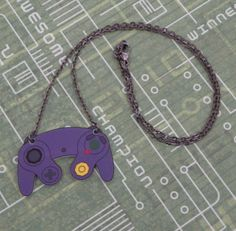 controller jewelry (PlayBox on etsy).  there are also earrings and rings and cufflinks... :)