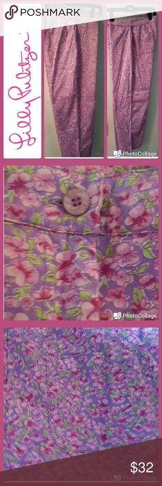 """Lilly Pulitzer pants In excellent condition.  Lilly Pulitzer pants. Pink cotton floral print slim cropped ankle style.  Flat front with zip. Back patch pocket.  Small front welt pockets. Waist 32"""", length 36"""", inseam 25"""". These pants scream summer! Lilly Pulitzer Pants Ankle & Cropped"""