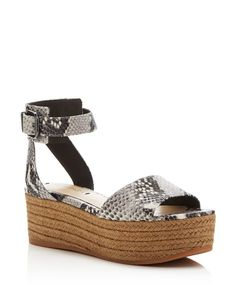 The '90s mainstay platform sandal goes graphic in a snake-embossed ankle-strap…