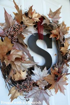 Metallic spray-paint turned bland faux leaves into a sparkling arrangement.  Get the tutorial at Frugal With a Flourish.