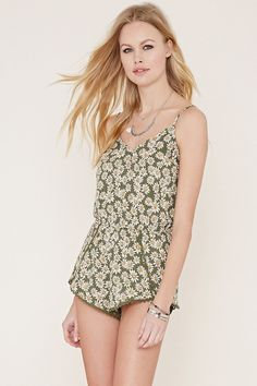 f73e1c8a5d0 Style Deals - This woven romper features an allover daisy print with  adjustable cami straps