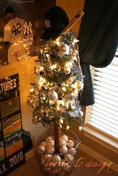 "baseball themed tree. same ""basket of balls"" idea could be used year round with regular house plants"