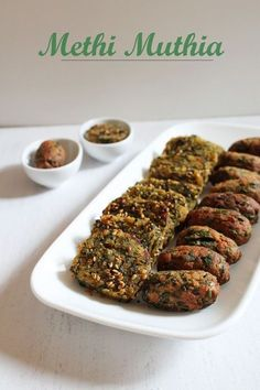Methi muthia recipe - There are two methods of making it: fried version steamed version. We usually prepare the steamed one for snacking purpose. While fried one to use into dishes like undhiyu and shaak. Jain Recipes, Gujarati Recipes, Veg Recipes, Indian Food Recipes, Vegetarian Recipes, Cooking Recipes, Healthy Recipes, Rajasthani Recipes, Gourmet