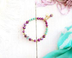 Bracelet Shéhérazade, fil élastique, perles or, violet, mauve, turquoise et menthe, breloque, mille et une nuits, pour femme