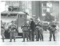 8.14.1961 - An East Berliner pleads with the East Berlin People's Police as he tries to cross the closed border.