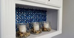 Don't let your budget limit your decorating options! Over at Small Home Soul, Toni used dollar store materials on a small budget to create an eye-catching backsplash. Find out what she did: [Dollar Store Glass Backsplash] Tags: backsplash, glass marbles Dollar Store Crafts, Dollar Stores, Iron Orchid Designs, Boho Home, Do It Yourself Home, Glass Containers, Glass Shelves, Amazing Bathrooms, Decorating Tips