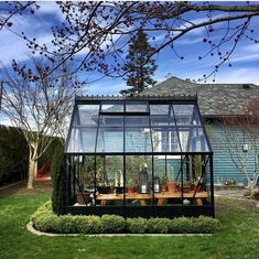 The Parkside 8x10 is our special anniversary greenhouse model with celebratory pricing at $7995. With decorative base panels to hide unsightly soil bags and pots, the base gives a high style effect without the high cost. Modern Greenhouses, 70th Anniversary, Indoor Plants, Custom Design, Gallery, Building, Tomatoes, Image, Beautiful