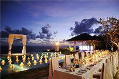 The glowing candle lights over the Dinner Table b by Tirtha Bridal Uluwatu Bali