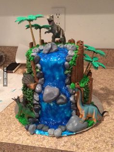 My best friend made my two-year-old a birthday cake. Cake 5 Year Old Boy, 3 Year Old Birthday Party Boy, Park Birthday, Baby Boy 1st Birthday, Dinosaur Cakes For Boys, Dinosaur Birthday Cakes, Jurassic World Cake, Jurassic Park, Safari Theme Party