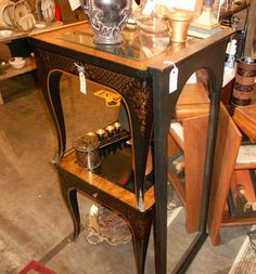 Go for the gold -- and black -- with this pair of sleek end tables! #GasLampToo T304, $395 http://www.gaslampantiques.com/magazine/treasure.php