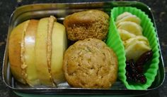 Bento for Baby 87:  Apple sandwich, zucchini and apricot muffins, banana chips, dried cherries