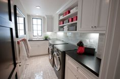 W/D not enclosed, cupboards/cabinets above... maybe utility sink with cupboards/counter across