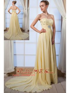 Light Yellow Empire Sweetheart Brush Train Chiffon Beading Homecoming Dress- $138.46  http://www.fashionos.com  Gorgeous light yellow prom dress will set you apart from the crowd. Delicate multicolor beading adorns the strapless empire sweetheart bodice. A-line skirt with from the empire waist for a flattering fit. A stunning zipper up back complestes this gorgeous design. This prom dress is everything that you've ever dreamed!